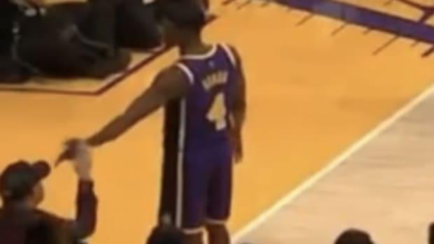 Rajon Rondo pointing at fan