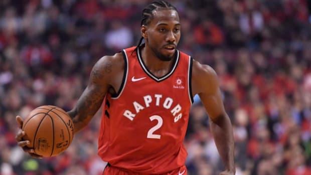 NBA-Raptors-Kawhi-Leonard-dribbling-against-Cavaliers-1040x572