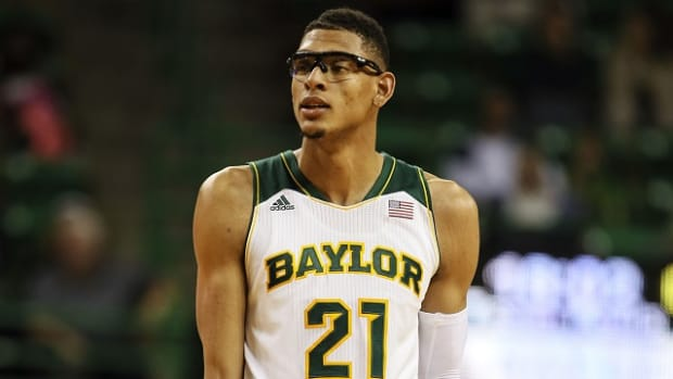 Nov 20, 2013; Waco, TX, USA; Baylor Bears center Isaiah Austin (21) reacts during the game against the Charleston Southern Buccaneers at The Ferrell Center. Baylor won 69-64. Mandatory Credit: Kevin Jairaj-USA TODAY Sports
