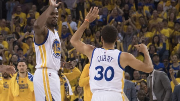May 14, 2017; Oakland, CA, USA; Golden State Warriors forward Kevin Durant (35) celebrates with guard Stephen Curry (30) during the second quarter in game one of the Western conference finals of the 2017 NBA Playoffs against the San Antonio Spurs at Oracle Arena. Mandatory Credit: Kyle Terada-USA TODAY Sports