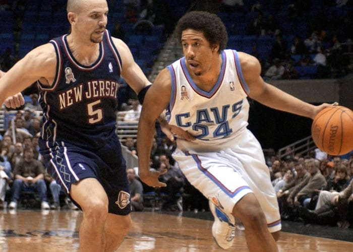 51703538-cleveland-cavaliers-guard-andre-miller-r-drives
