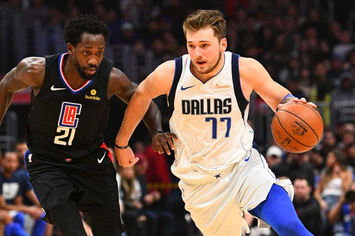 Patrick Beverley attempting to guard Luka Doncic