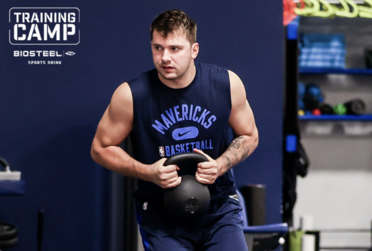 Luka Doncic holding a weight