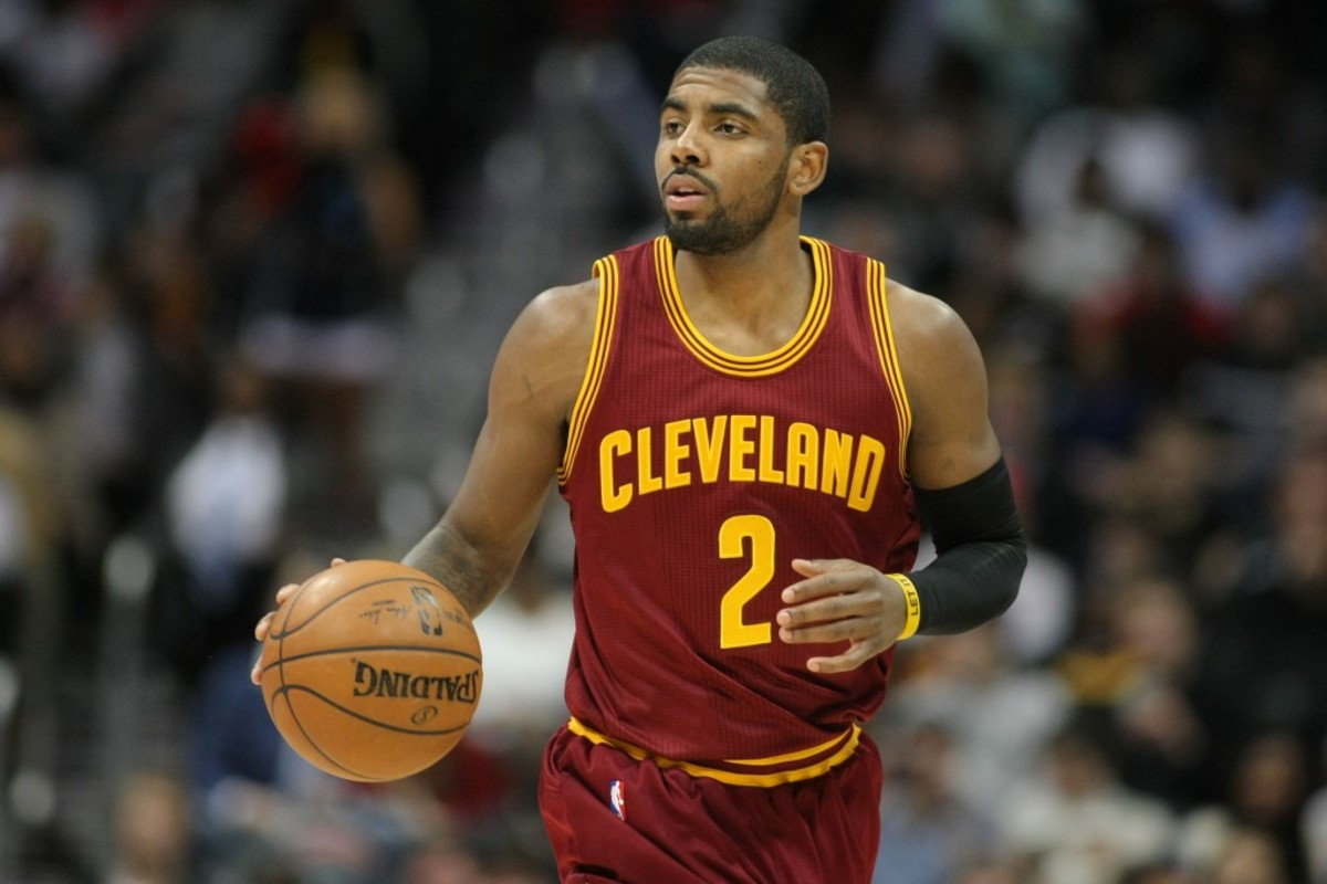 Dec 30, 2014; Atlanta, GA, USA; Cleveland Cavaliers guard Kyrie Irving (2) dribbles the ball against the Atlanta Hawks in the first quarter at Philips Arena. Mandatory Credit: Brett Davis-USA TODAY Sports