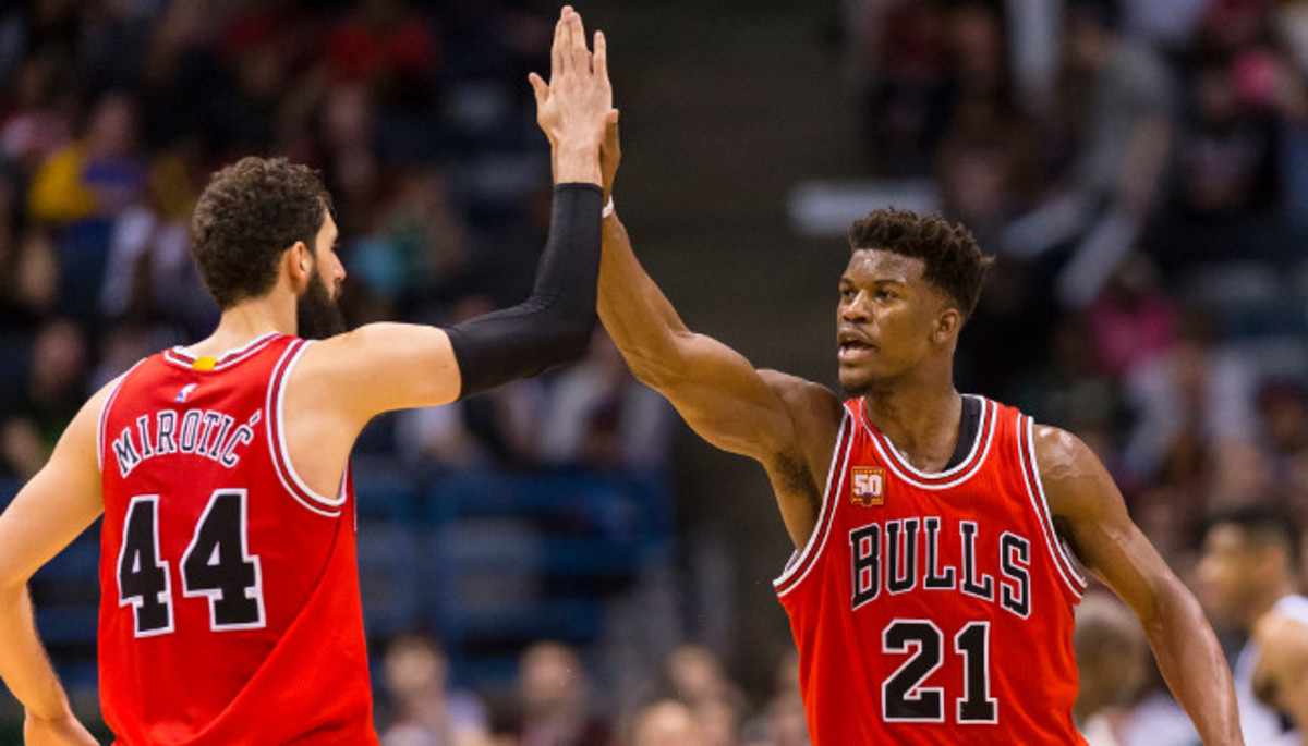 Apr 3, 2016; Milwaukee, WI, USA; Chicago Bulls guard Jimmy Butler (21) celebrates with forward Nikola Mirotic (44) during the fourth quarter against the Milwaukee Bucks at BMO Harris Bradley Center.  Chicago won 102-98.  Mandatory Credit: Jeff Hanisch-USA TODAY Sports