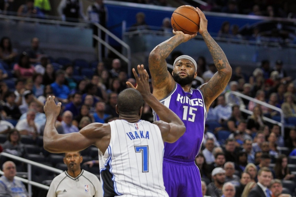 Nov 3, 2016; Orlando, FL, USA;  Orlando Magic forward Serge Ibaka (7) defends Sacramento Kings center DeMarcus Cousins (15) in the first quarter at Amway Center. Mandatory Credit: Logan Bowles-USA TODAY Sports