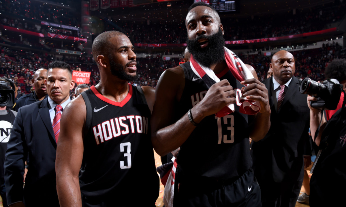 HOUSTON, TX - MAY 8:  Chris Paul #3 and James Harden #13 of the Houston Rockets after the game against the Utah Jazz in Game Five of the Western Conference Semifinals of the 2018 NBA Playoffs on May 8, 2018 at the Toyota Center in Houston, Texas. NOTE TO USER: User expressly acknowledges and agrees that, by downloading and or using this photograph, User is consenting to the terms and conditions of the Getty Images License Agreement. Mandatory Copyright Notice: Copyright 2018 NBAE (Photo by Bill Baptist/NBAE via Getty Images)
