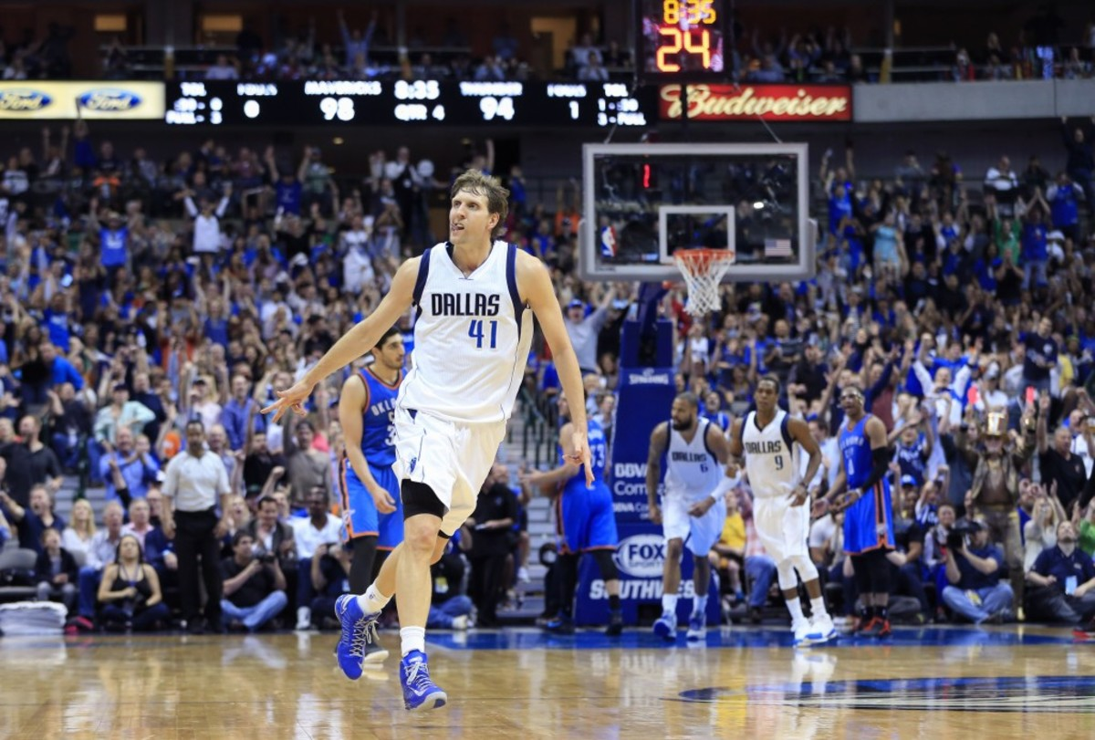 Mar 16, 2015; Dallas, TX, USA; Dallas Mavericks forward Dirk Nowitzki (41) celebrates after scoring during the second half against the Oklahoma City Thunder at American Airlines Center. Mandatory Credit: Kevin Jairaj-USA TODAY Sports