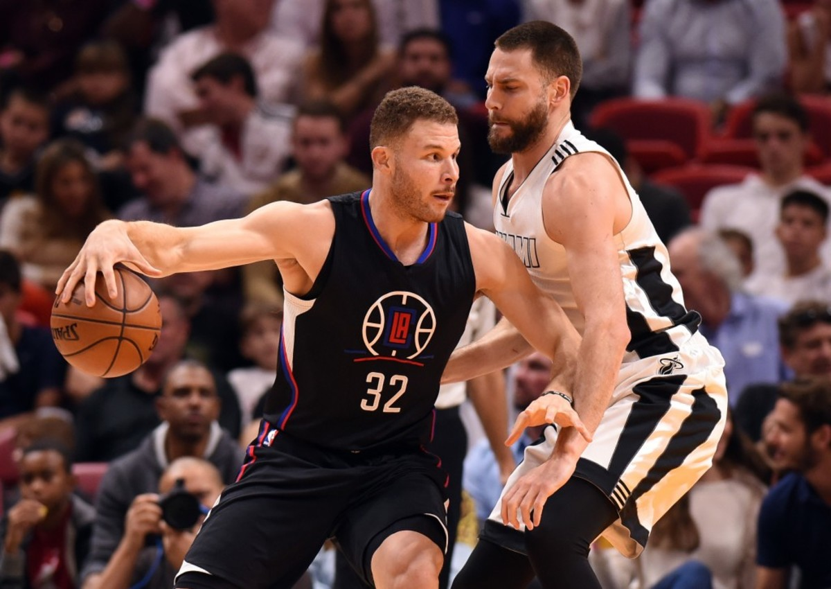 Dec 16, 2016; Miami, FL, USA; LA Clippers forward Blake Griffin (32) is pressured by Miami Heat forward Josh McRoberts (4) during the second half at American Airlines Arena. The Clippers won 102-98. Mandatory Credit: Steve Mitchell-USA TODAY Sports