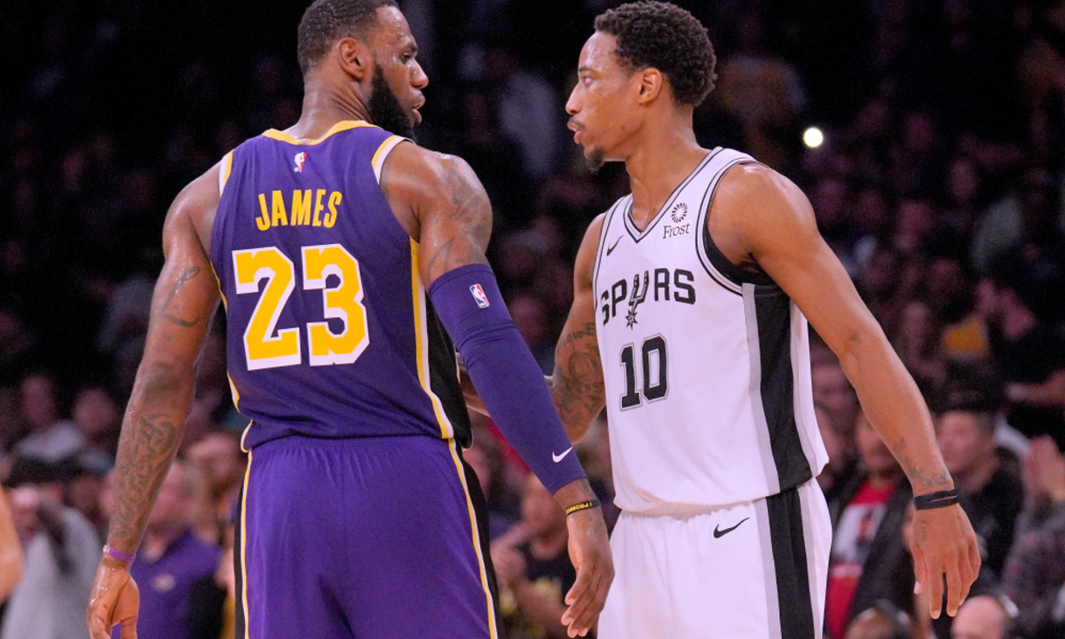 LOS ANGELES, CA - DECEMBER 05:  LeBron James #23 of the Los Angeles Lakers and DeMar DeRozan #10 of the San Antonio Spurs shake hands at the end of the game during a 121-113 Laker win at Staples Center on December 5, 2018 in Los Angeles, California.  NOTE TO USER: User expressly acknowledges and agrees that, by downloading and or using this photograph, User is consenting to the terms and conditions of the Getty Images License Agreement.  (Photo by Harry How/Getty Images)