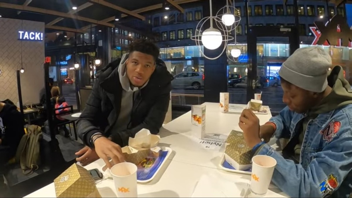Giannis Antetokounmpo Casually Shares A Burger With Friends In Sweden, The Country Where Nobody Knows Him