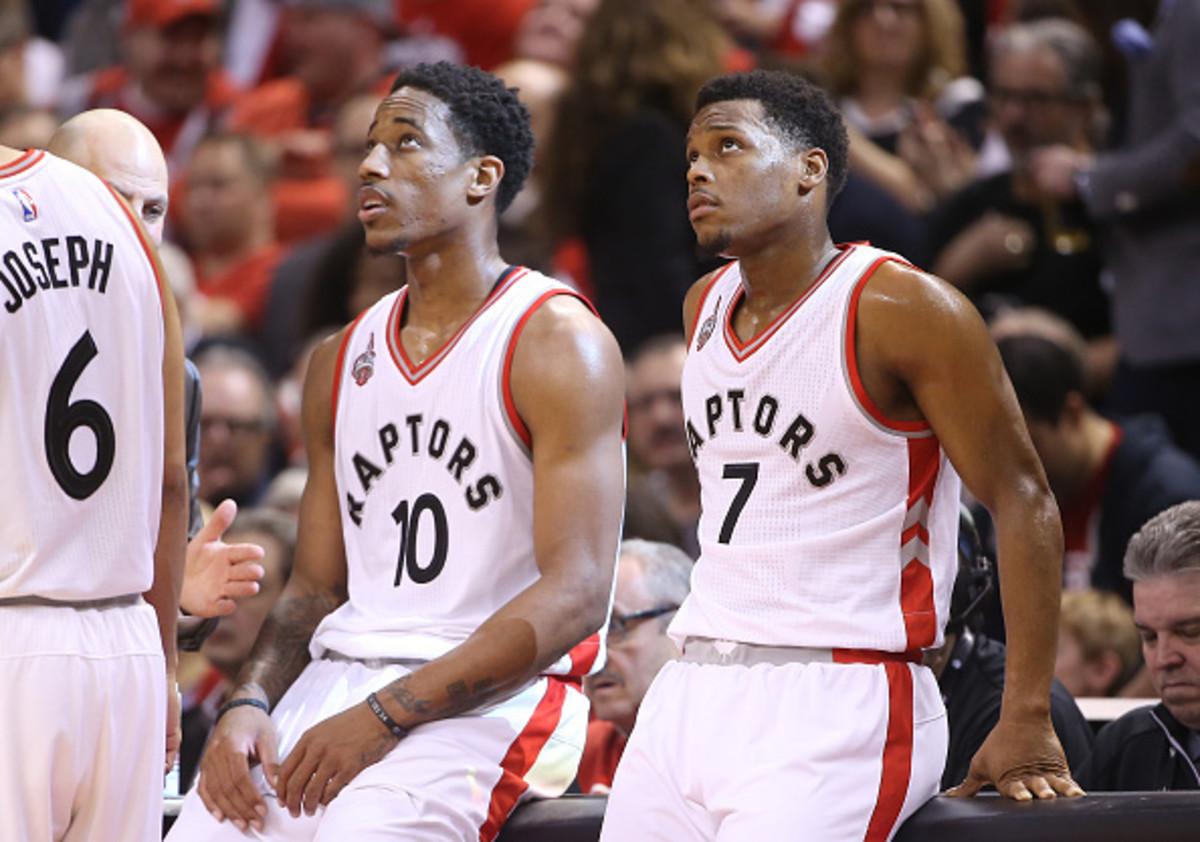 TORONTO, CANADA - APRIL 16: Kyle Lowry #7 (R) of the Toronto Raptors and DeMar DeRozan #10 (L) look on against the Indiana Pacers in Game One of the Eastern Conference Quarterfinals during the 2016 NBA Playoffs on April 16, 2016 at the Air Canada Centre in Toronto, Ontario, Canada. NOTE TO USER: User expressly acknowledges and agrees that, by downloading and or using this photograph, User is consenting to the terms and conditions of the Getty Images License Agreement. (Photo by Tom Szczerbowski/Getty Images)