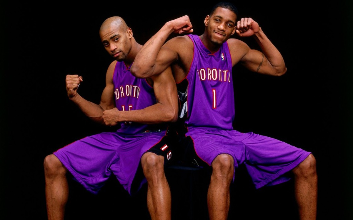 OAKLAND, CA - FEBRUARY 13:  Vince Carter #15 and Tracy McGrady #1 of the Toronto Raptors pose for a portrait together during the 2000 NBA All-Star Weekend  on February 13, 2000 in Oakland, California.  NOTE TO USER: User expressly acknowledges and agrees that, by downloading and/or using this Photograph, user is consenting to the terms and conditions of the Getty Images License Agreement.  Mandatory Copyright Notice: Copyright 2000 NBAE (Photo by Andy Hayt/NBAE via Getty Images)