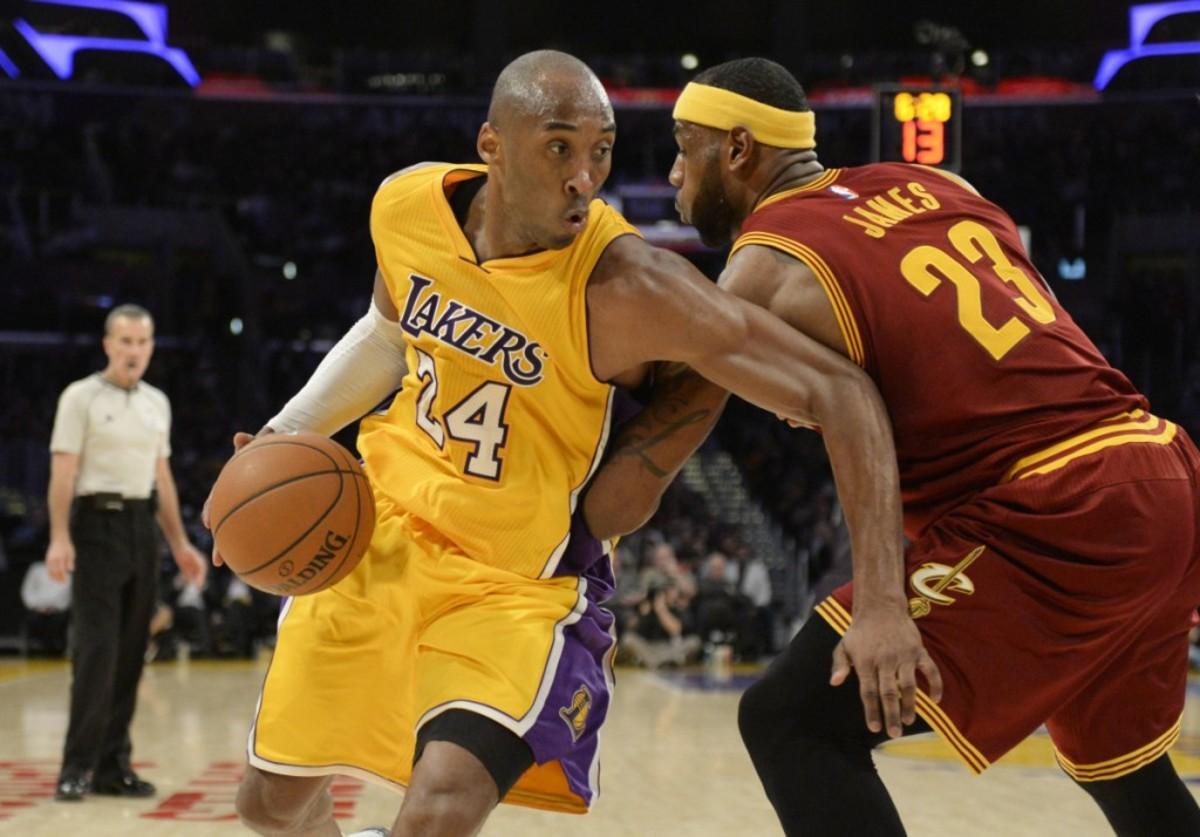 Jan 15, 2015; Los Angeles, CA, USA; Los Angeles Lakers guard Kobe Bryant (24) drives to the basket against Cleveland Cavaliers forward LeBron James Mandatory Credit: Richard Mackson-USA TODAY Sports
