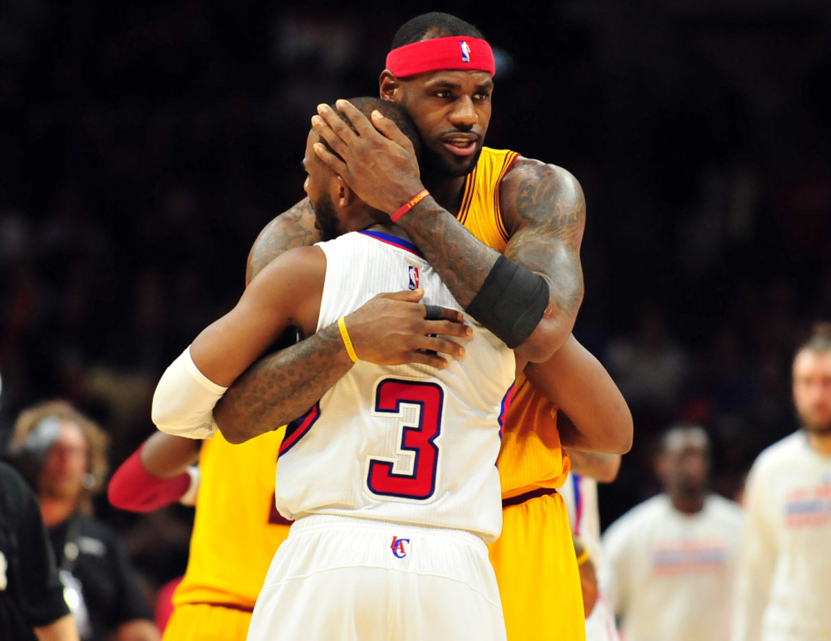 January 16, 2015; Los Angeles, CA, USA; Cleveland Cavaliers forward LeBron James (23) meets with Los Angeles Clippers guard Chris Paul (3) following the 126-121 victory at Staples Center. Mandatory Credit: Gary A. Vasquez-USA TODAY Sports  ORG XMIT: USATSI-187430 ORIG FILE ID:  20150116_gav_sv5_052.jpg