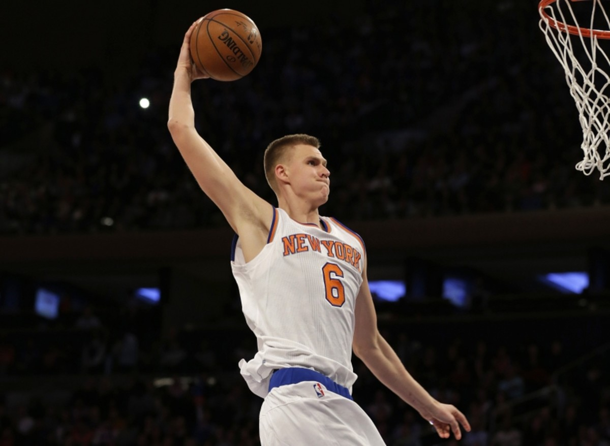 Feb 26, 2016; New York, NY, USA; New York Knicks forward Kristaps Porzingis (6) slam dunks the ball against the Orlando Magic during the second half at Madison Square Garden. The Knicks defeated the Magic 108-95. Mandatory Credit: Adam Hunger-USA TODAY Sports