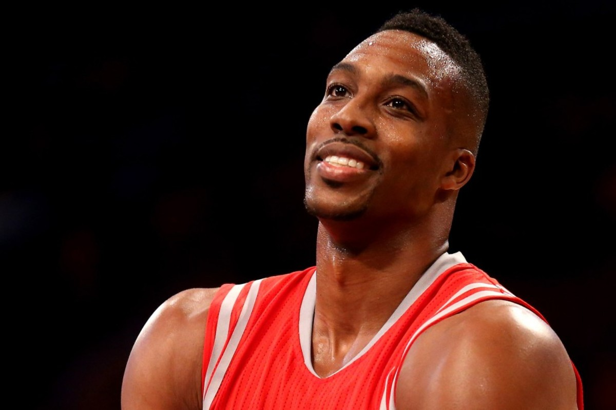 LOS ANGELES, CA - OCTOBER 28: Dwight Howard #12 of the Houston Rockets on the court in the game with the Los Angeles Lakers at Staples Center on October 28, 2014 in Los Angeles, California.  The Rockets won 108-90. NOTE TO USER: User expressly acknowledges and agrees that, by downloading and or using this photograph, User is consenting to the terms and conditions of the Getty Images License Agreement.  (Photo by Stephen Dunn/Getty Images)