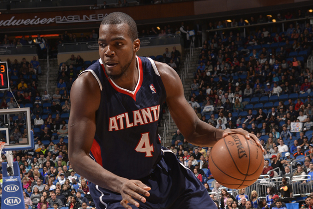 ORLANDO, FL - JANUARY 22: Paul Millsap #4 of the Atlanta Hawks dribbles up the court against the Orlando Magic during the game on January 22, 2014 at Amway Center in Orlando, Florida. NOTE TO USER: User expressly acknowledges and agrees that, by downloading and or using this photograph, User is consenting to the terms and conditions of the Getty Images License Agreement. Mandatory Copyright Notice: Copyright 2014 NBAE  (Photo by Fernando Medina/NBAE via Getty Images)
