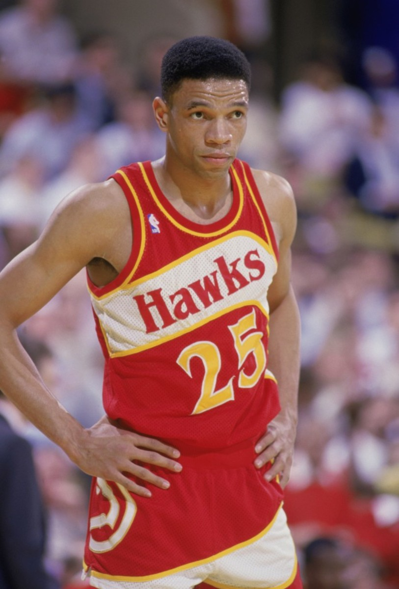 """INGLEWOOD, CA - 1987:  Glenn """"Doc"""" Rivers #25 of the Atlanta Hawks stands on the court during a NBA game against the Los Angeles Lakers at the Great Western Forum in Inglewood, California in 1987.  (Photo by Stephen Dunn/Getty Images)"""