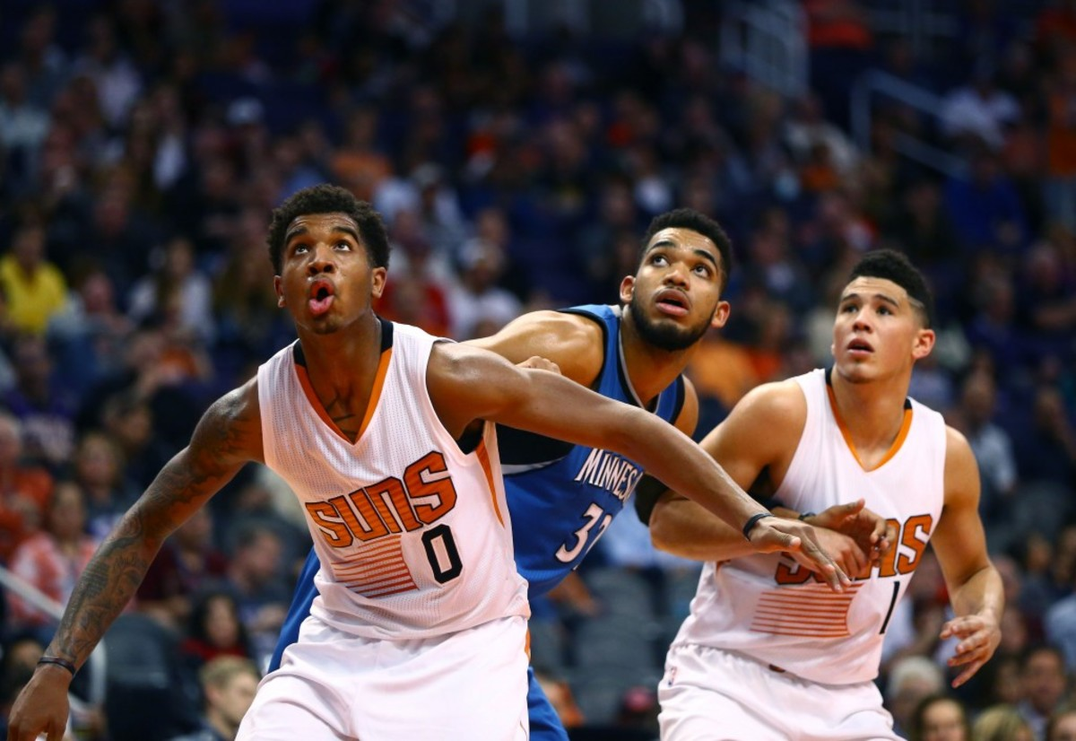 Nov 25, 2016; Phoenix, AZ, USA; Phoenix Suns forward Marquese Chriss (left) and guard Devin Booker (right) against Minnesota Timberwolves center Karl-Anthony Towns at Talking Stick Resort Arena. The Timberwolves defeated the Suns 98-85. Mandatory Credit: Mark J. Rebilas-USA TODAY Sports