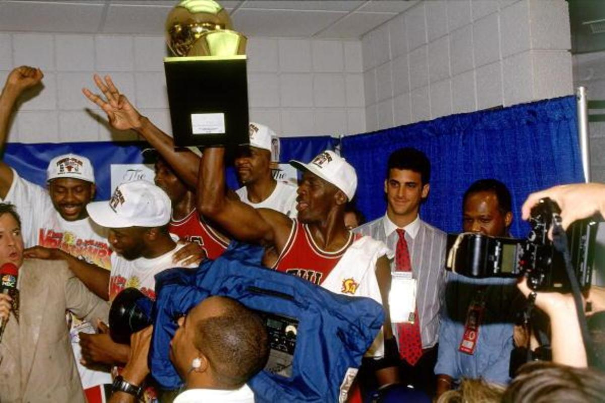 PHOENIX - JUNE 20:  Michael Jordan #23 of the Chicago Bulls celebrates winning the 1993 NBA Championship after defeating the Phoenix Suns in Game Six of the 1993 NBA Finals on June 20, 1993 at the America West Arena in Phoenix, Arizona.  The Bulls won 99-98.  NOTE TO USER:  User expressly acknowledges and agrees that, by downloading and/or using this photograph, user is consenting to the terms and conditions of the Getty Images License Agreement.  Mandatory Copyright Notice: Copyright 1993 NBAE  (Photo by Nathaniel S. Butler/NBAE via Getty Images)
