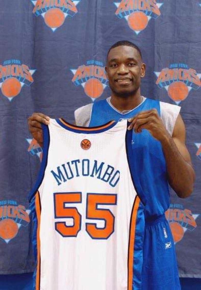 TARRYTOWN, NY - OCTOBER 10:  Dikembe Mutombo #55 of the New York Knicks poses for a portrait during a press conference on October 10, 2003 in Tarrytown, New York.  NOTE TO USER: User expressly acknowledges and agrees that, by downloading and/or using this Photograph, User is consenting to the terms and conditions of the Getty Images License Agreement.  (Photo by Jennifer Pottheiser/NBAE via Getty Images)