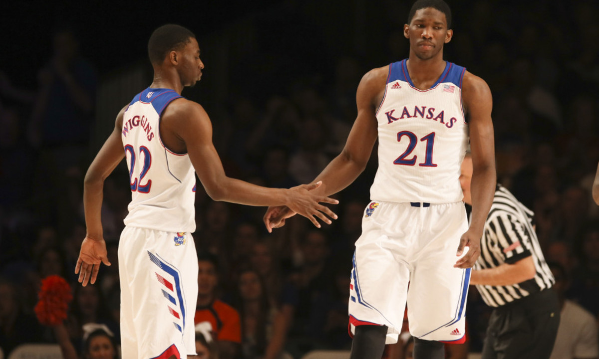 Nov 30, 2013; Paradise Island, BAHAMAS; Kansas Jayhawks guard Andrew Wiggins (22) and center Joel Embiid (21) react after a score during the game against the UTEP Miners at the 2013 Battle 4 Atlantis in the Imperial Arena at the Atlantis Resort. Mandatory Credit: Kevin Jairaj-USA TODAY Sports ORG XMIT: USATSI-165118 ORIG FILE ID:  20131130_krj_aj6_233.JPG