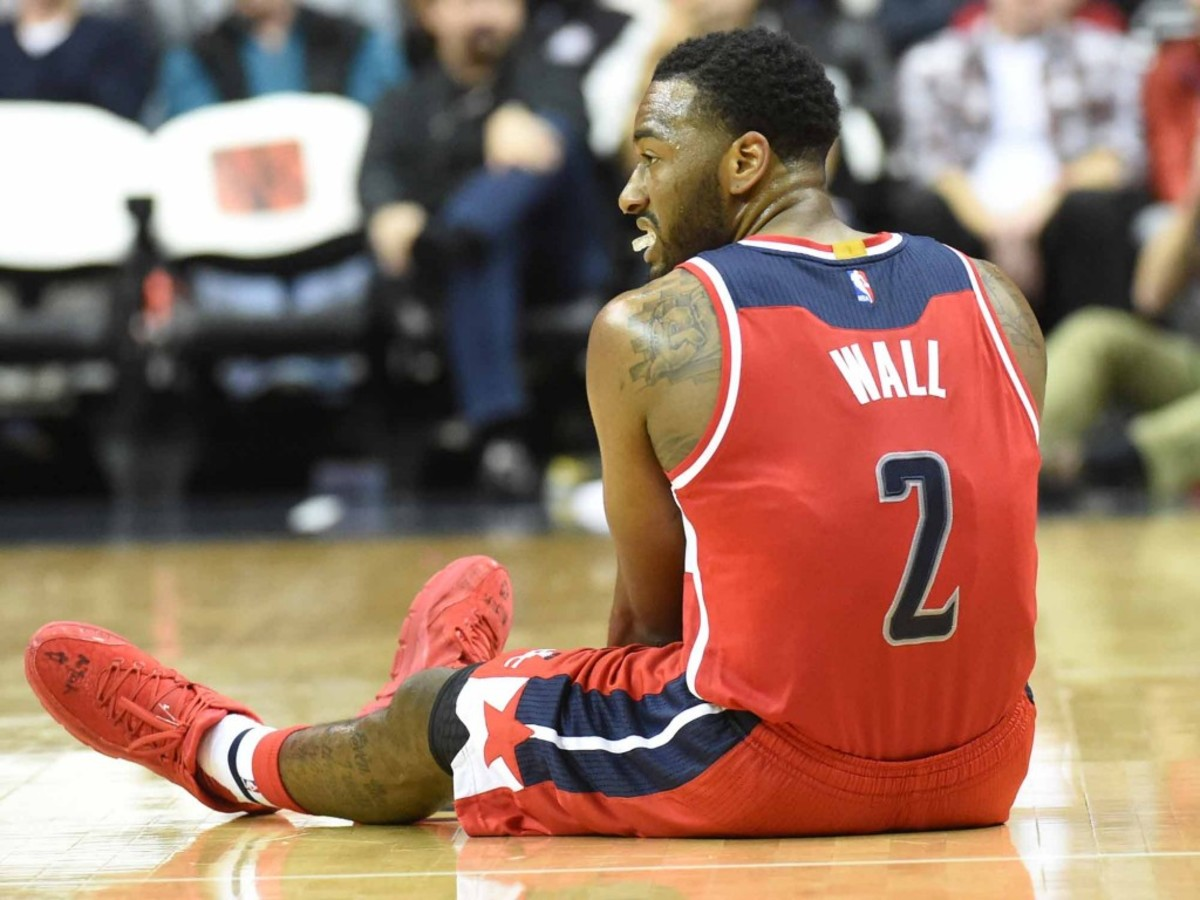 WASHINGTON, DC - DECEMBER, 6:   Washington Wizards guard John Wall (2) goes down after hurting his right knee against the Dallas Mavericks on December 6, 2015 in Washington, DC. (Jonathan Newton / The Washington Post via Getty Images)