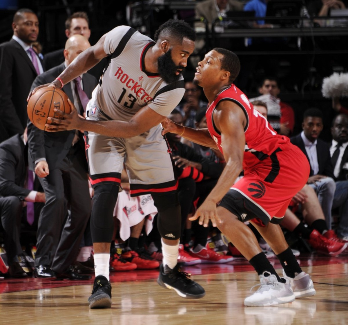 HOUSTON, TX - NOVEMBER 23:  James Harden #13 of the Houston Rockets handles the ball against Kyle Lowry #7 of the Toronto Raptors during a game on November 23, 2016 at the Toyota Center in Houston, Texas. NOTE TO USER: User expressly acknowledges and agrees that, by downloading and or using this photograph, user is consenting to the terms and conditions of the Getty Images License Agreement. Mandatory Copyright Notice: Copyright 2016 NBAE (Photo by Bill Baptist/NBAE via Getty Images)
