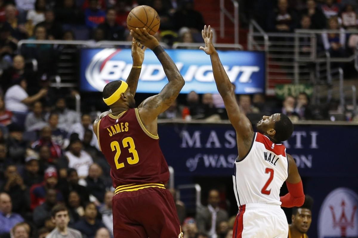 Feb 20, 2015; Washington, DC, USA; Cleveland Cavaliers forward LeBron James (23) shoots the ball over Washington Wizards guard John Wall (2) in the first quarter at Verizon Center. Mandatory Credit: Geoff Burke-USA TODAY Sports