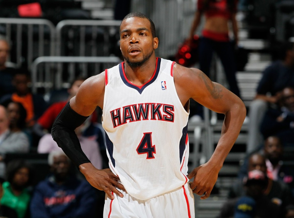ATLANTA, GA - DECEMBER 18:  Paul Millsap #4 of the Atlanta Hawks against the Sacramento Kings at Philips Arena on December 18, 2013 in Atlanta, Georgia.  NOTE TO USER: User expressly acknowledges and agrees that, by downloading and or using this photograph, User is consenting to the terms and conditions of the Getty Images License Agreement  (Photo by Kevin C. Cox/Getty Images)