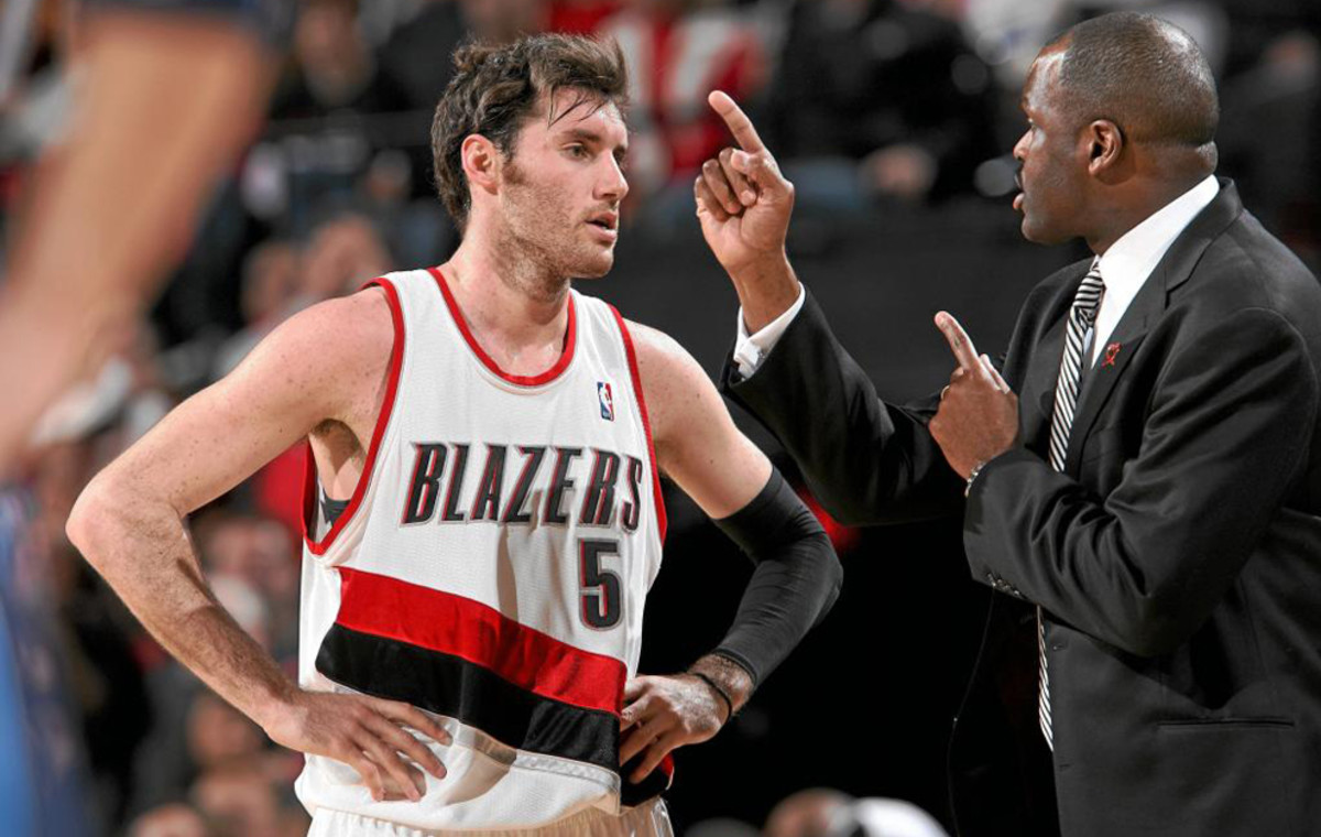 PORTLAND, OR - MARCH 25: Rudy Fernandez #5 of the Portland Trail Blazers listens to instructions by head coach Nate McMillan during the game against the Dallas Mavericks at The Rose Garden on March 25, 2010 in Portland, Oregon. The Blazers won 101-89. NOTE TO USER: User expressly acknowledges and agrees that, by downloading and/or using this Photograph, user is consenting to the terms and conditions of the Getty Images License Agreement. Mandatory Copyright Notice: Copyright 2010 NBAE (Photo by Sam Forencich/NBAE via Getty Images)