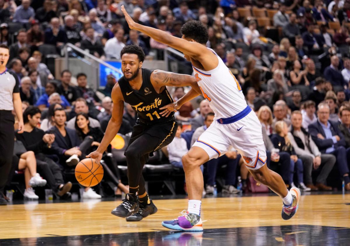 Nov 27, 2019; Toronto, Ontario, CAN; Toronto Raptors guard Shamorie Ponds (11) dribbles against New York Knicks guard Allonzo Trier (14) at Scotiabank Arena. Mandatory Credit: John E. Sokolowski-USA TODAY Sports